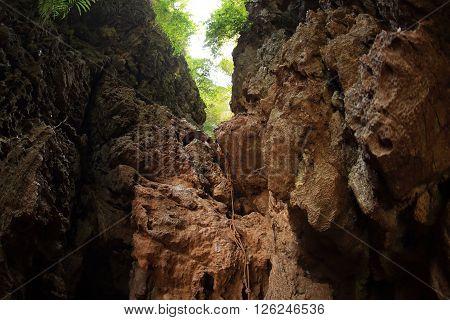 closeup of climbing rope on steep mountain rock