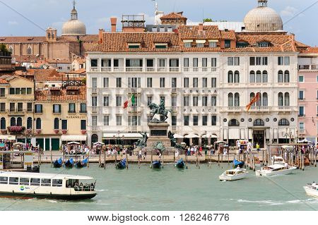 VENICE ITALY - JULY 10 2009: Victor Emmanuel II monument in front of Londra Palace hotel as seen fron the lagoon