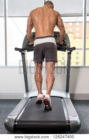 Young Man On Treadmill Back View
