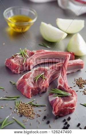 Raw lamb cutlets with spices and onion before marinating