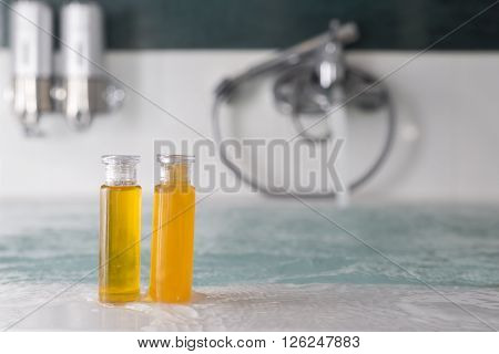 Background series : Bottle of shampoo and bath gel on the edge of bathtub