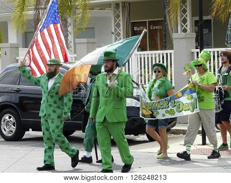CRYSTAL RIVER FL - March 17: on March 17 2016 people carrying flags and wearing green march in a parade to celebrate Saint Patrick's Day in Crystal