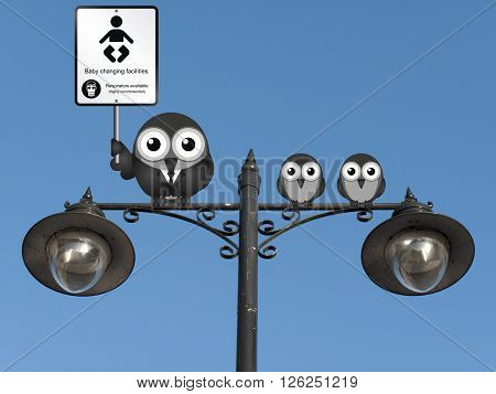 Comical baby changing facilities sign with parent and young birds perched on a lamppost against a clear blue sky