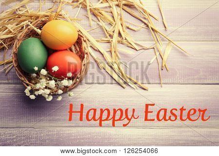 Easter eggs in wicker basket, top vie. Retro stylization