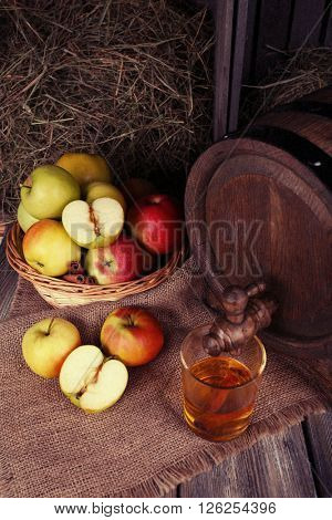 Composition of fresh apples and tasty cider on wooden table