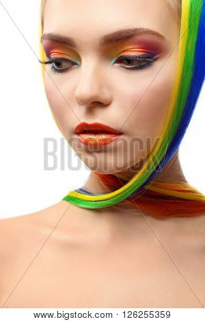 Beautiful girl with colorful makeup and hairstyle on white background