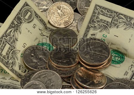 Savings thrift poverty taxes riches couch cushion money dollars dimes nickels and quarters