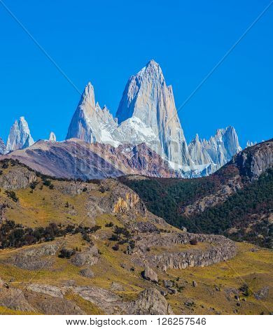 Tremendous Patagonia in February. Amazing tops of Mountains Fitzroy are lit with the midday sun