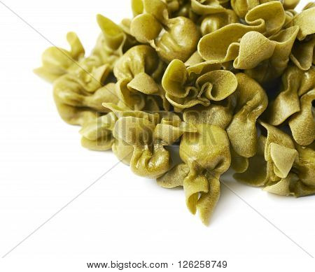 Pile of sacchettoni stuffed sacchetti pasta isolated over the white background, close-up crop fragment as a copyspace backdrop composition