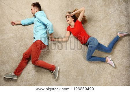Scene simulation, young couple running and jumping