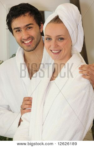 Young couple in bathrobe in the bathroom
