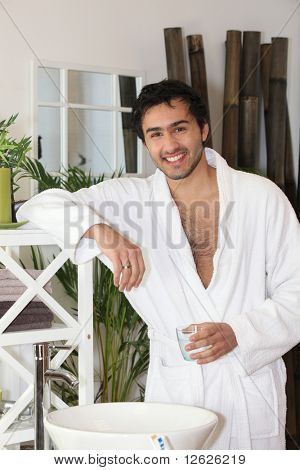Man in bathrobe in the bathroom