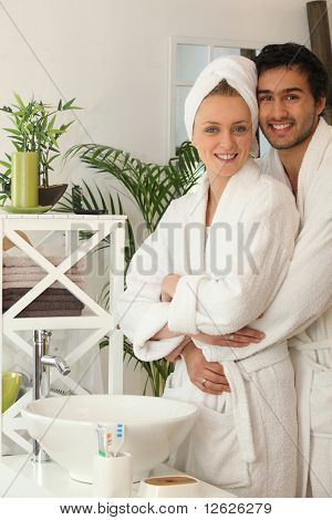 Portrait of a couple in bathrobe in the bathroom