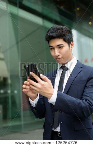 Business man sending sms