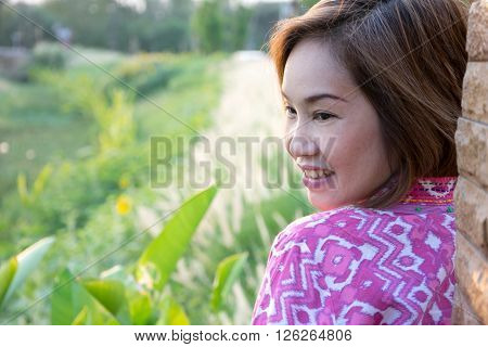 Portrait Woman Side With View Of Grass Backlit