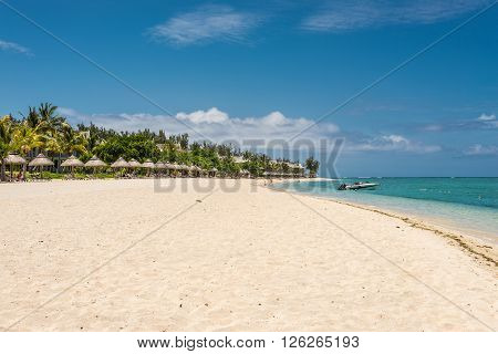 Le Morne Mauritius - December 7 2015: People relax on the Beach at Le Morne Brabant one of the finest beaches in Mauritius and the site of many hotels and tourism facilities.