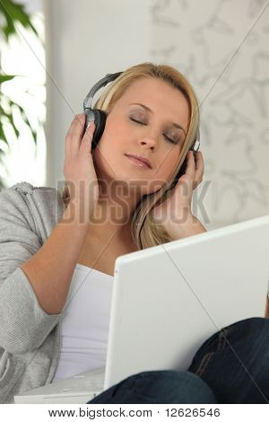 Portrait of a young woman relaxing listening to music