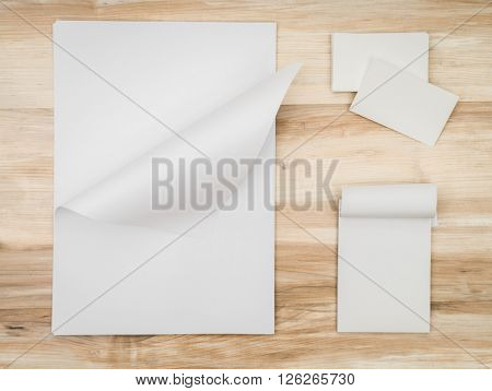 Name card and White template paper on wooden background