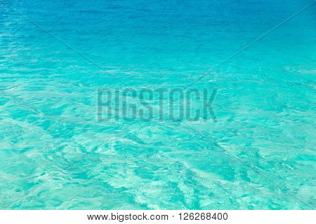travel, tourism, vacation and summer holidays concept - sea or ocean blue transparent water