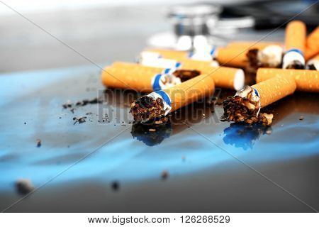Cigarettes and stethoscope on x-ray lung, close up