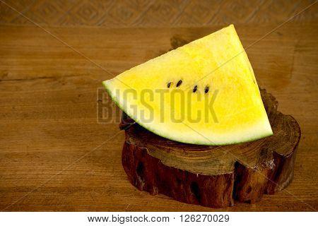 Yellow Water Mellon On Wood Teak