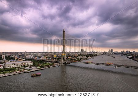 Thailand, Bangkok, view of the Rama VIII Bridge and the Chao Praya river at sunset