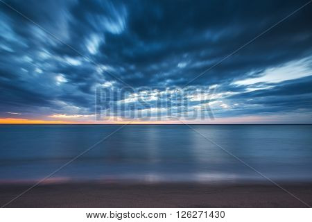 Dramatic cloudscape over the sea long exposure