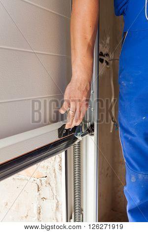 Worker open a garage door during installation