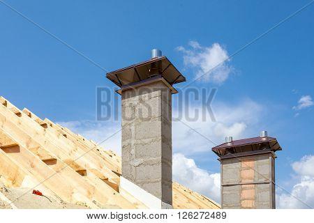 New chimney (smokestack) with metal box closeup