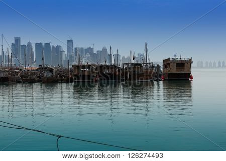 DOHA, QATAR, 15-APRIL-2016: Doha port with traditional fishing boats, boats are completely loaded with all necessary staff to do the trip with passengers or to take a fish. Doha, Qatar, shoot made 5 April 2016, around 6 am