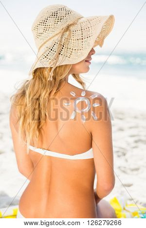 Woman with sunscreen on her skin on a sunny day