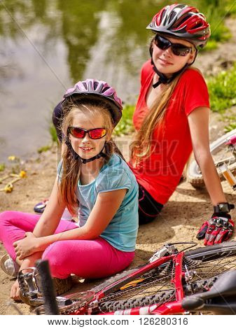 Bikes cycling family. Happy mother and daughter  rides bicycle.