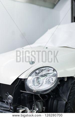 Auto body repair series : Masked white car before repaint