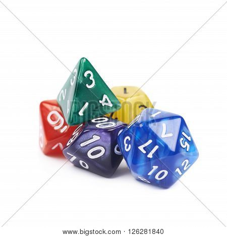Pile of colorful roleplaying polyhedral dices isolated over the white background