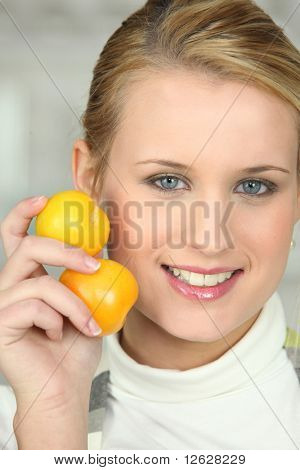 Young woman with yellow plums