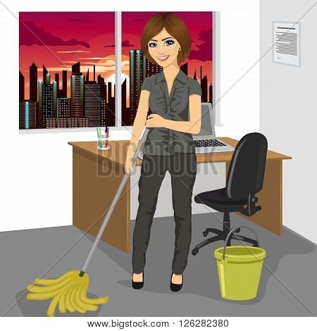 Full length portrait of young woman mopping floor with bucket and mop in office
