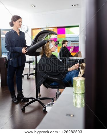 Woman Dying Hair In Beauty Salon