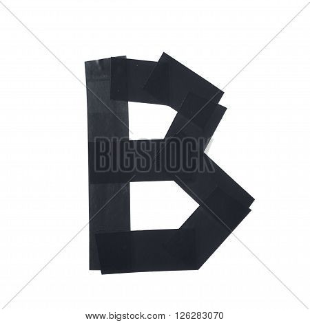 Letter B symbol made of insulating tape pieces, isolated over the white background