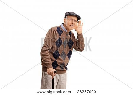 Studio shot of a senior man struggling to hear something isolated on white background