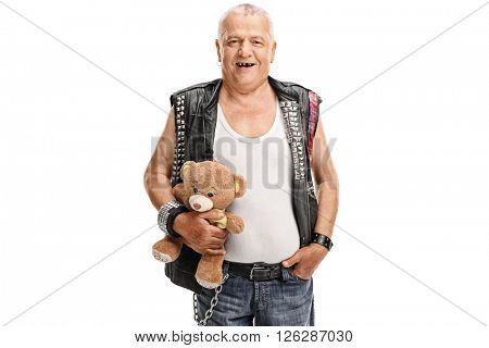 Studio shot of a mature punk rocker holding a teddy bear isolated on white background