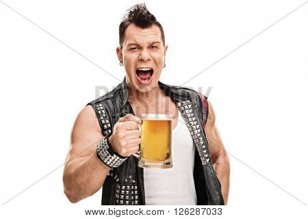 Studio shot of a male punk in an old black jacket holding a pint of beer isolated on white background