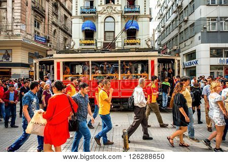 ISTANBUL - MAY 28, 2015: Crowded Istiktal avenue with tram in the Pera region in Istanbul. Istiktal avenue is one of the most famous avenues in Istanbul, visited by nearly 3 million people in a day