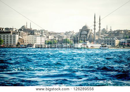 ISTANBUL - MAY 28, 2015: Cityscape view with Sultanahmet mosque on the European part of Istanbul city from Galata coast with blue waterfront