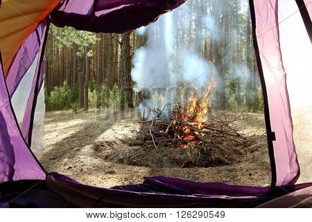 Overview of tourist tents. Burning fire.  travel ** Note: Soft Focus at 100%, best at smaller sizes