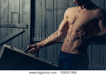 Muscular Man With Suitcase