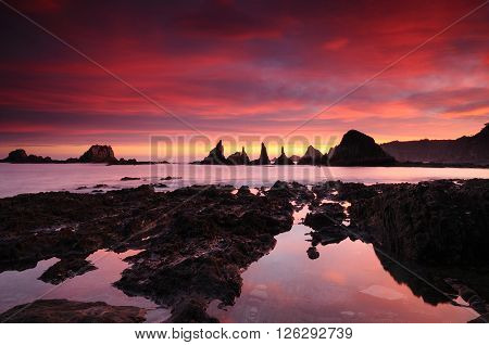 Beautiful Sunrise In Rocky Waterscape