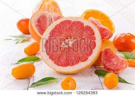 Grapefruit on a wooden table, close-up.