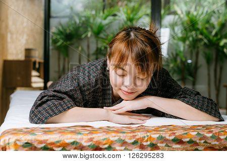 Massage series : Asian woman lying on massage bed