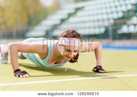 Young Attractive Woman Doing Push-up Or Core