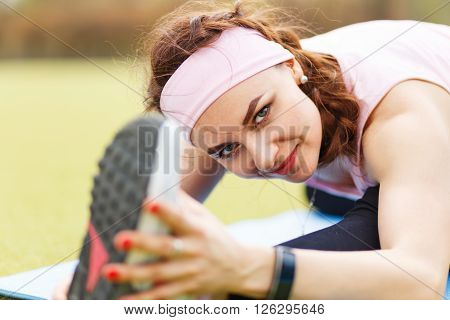 Young Sporty Girl Doing Stretching On Fitness Mat